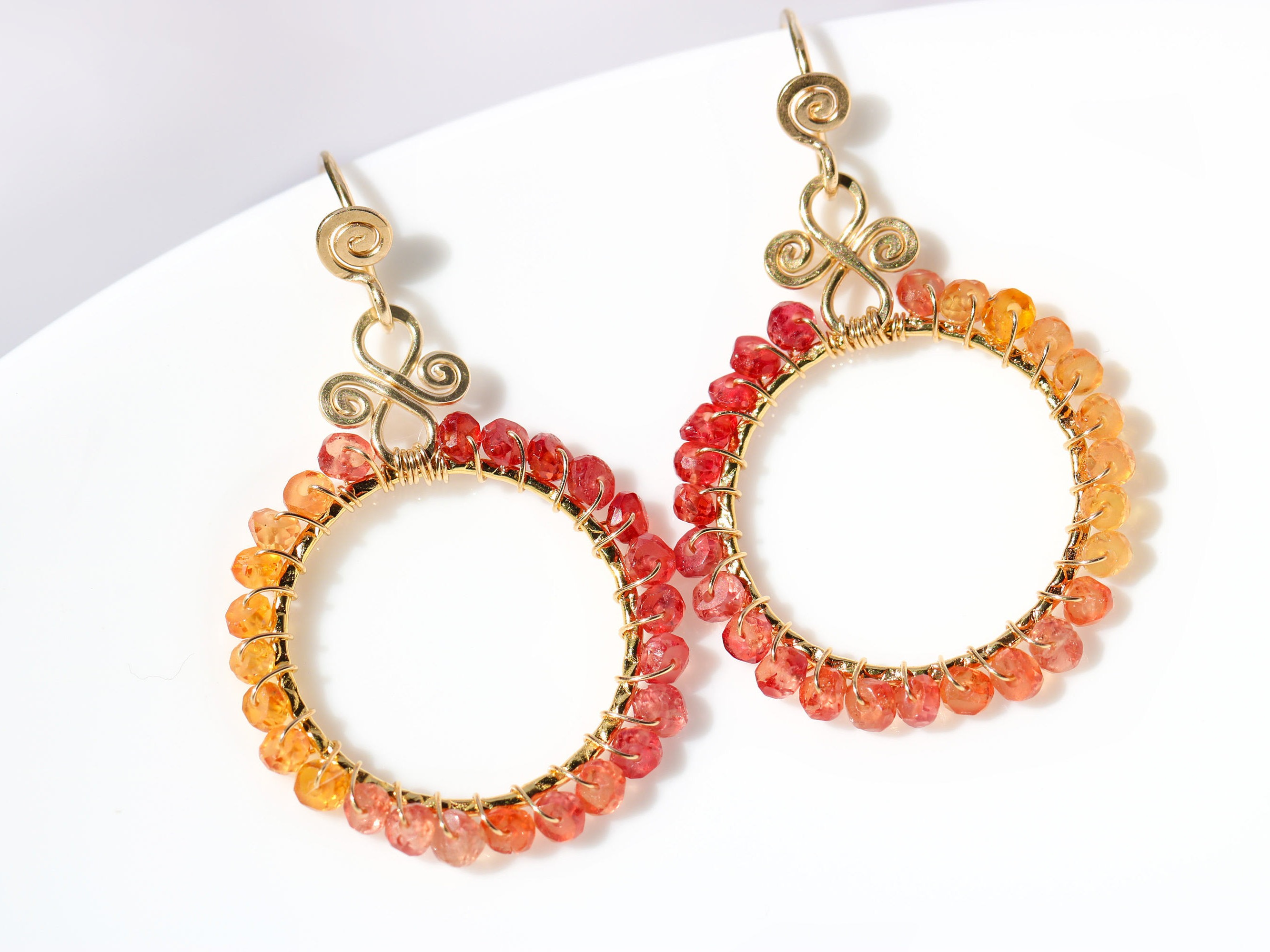 orange and songea sapphires wire wrapped hoop earrings in gold